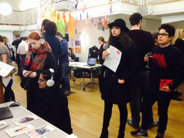Interested visitors to the Things We Keep presentation at the showcase event, February 2016.